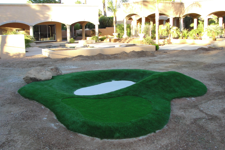 Synthetic putting green with bunker