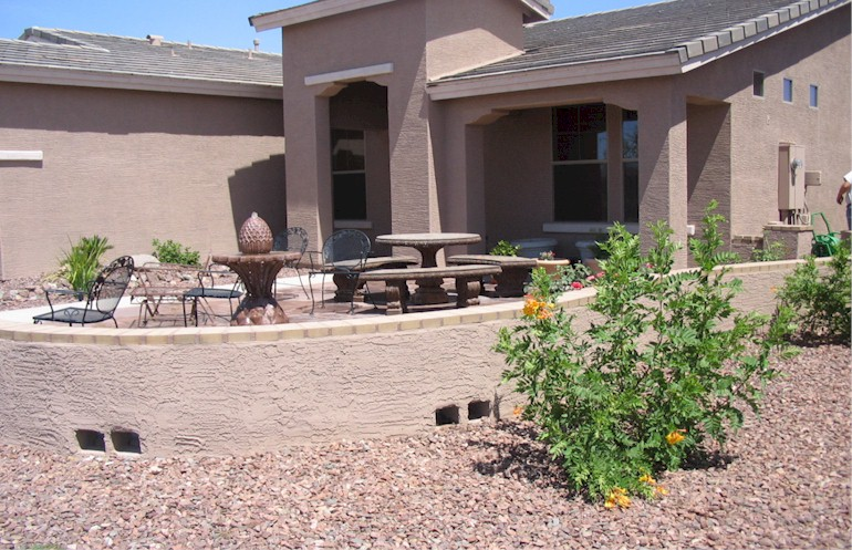 Desert landscaped front yard with pony wall low maintenance