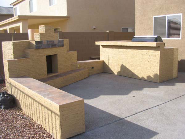 stucco fireplace BBQ aggregate concrete patio