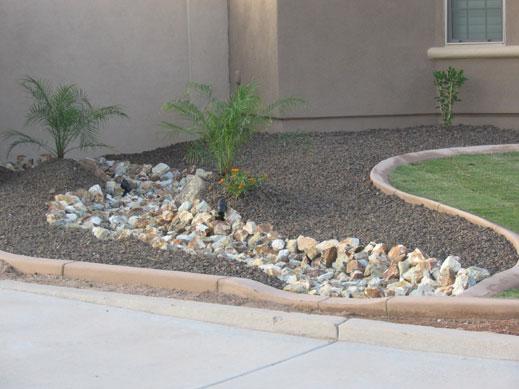Arizona desert landscape design with riverbeds rock plants for Desert landscaping ideas