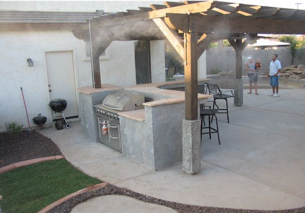 Patio misting system on gazebo with pump