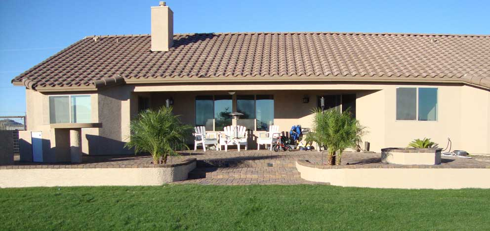 raised paver patio backyard landscape