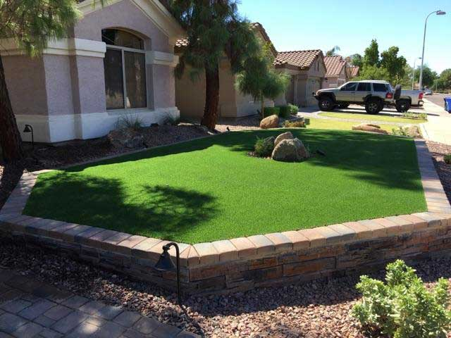 synthetic grass raised area front yard