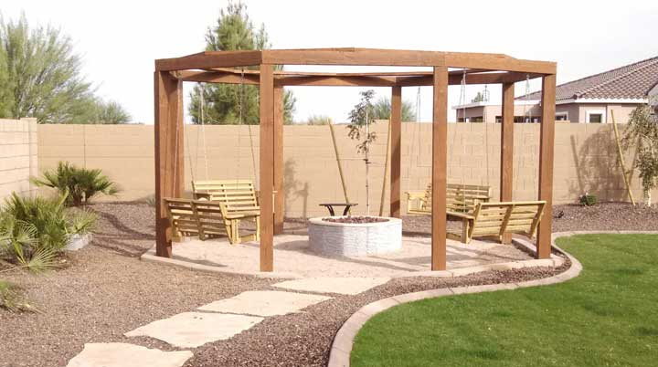 Gas fire pit with gazebo and swings - Fire Pits Designed By Az Living Landscape. Call 480-390-4477