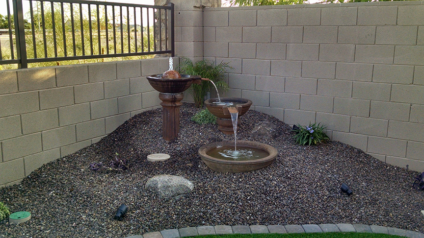 small backyard landscaping with fountain