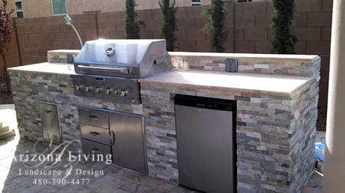 built-in grill with travertine counter